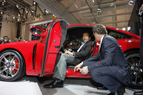 Arnold Schwarzenegger visits the Porsche stand at Geneva Motor Show | CarTrade.com
