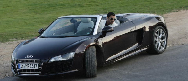 John Abraham looks out of his Audi R8 Spyder in a still from the upcoming Race 2