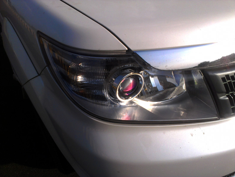 Tata Safari Storme Projector head light image